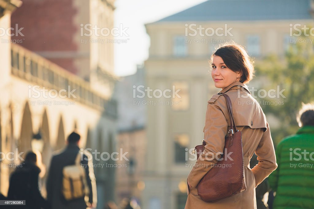 Woman on Main Market Square in Krakow. stock photo