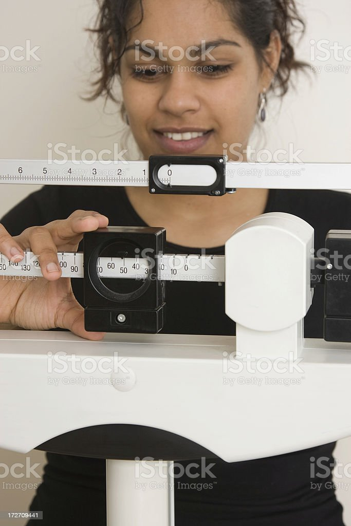woman on medical weight scale royalty-free stock photo
