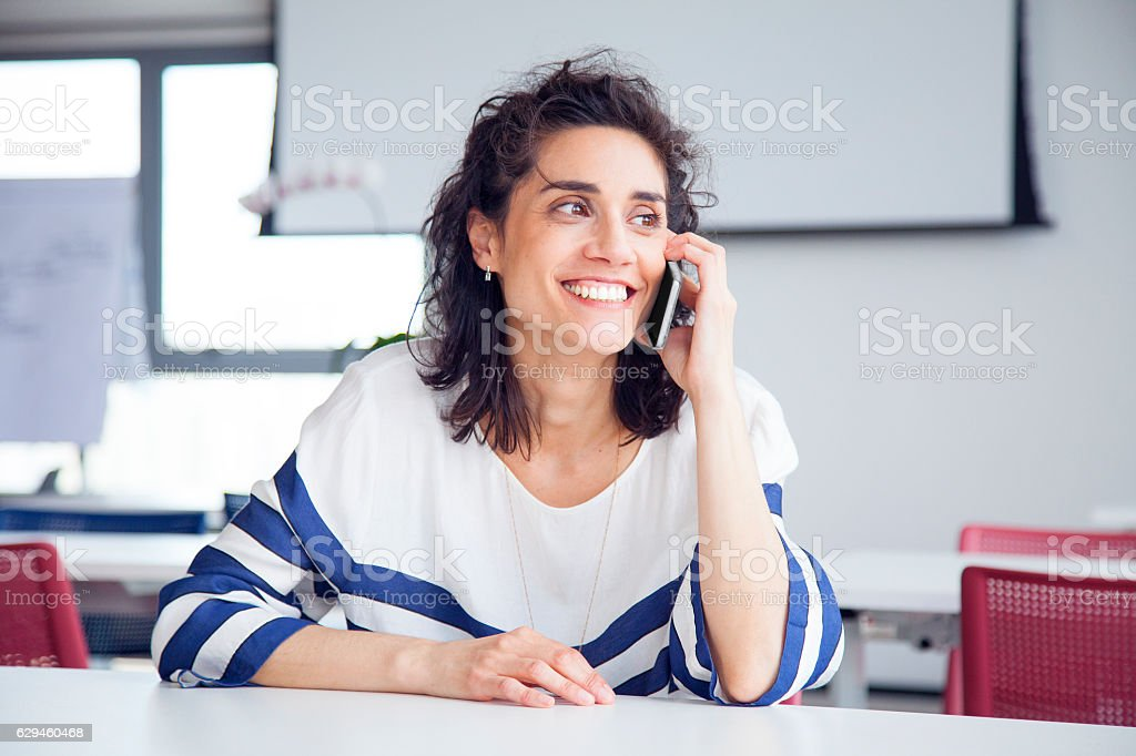 woman on mobile phone smilling stock photo
