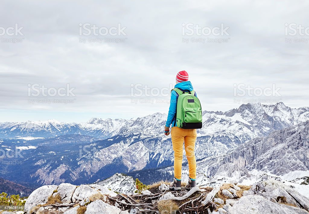Woman on mountain peak stock photo