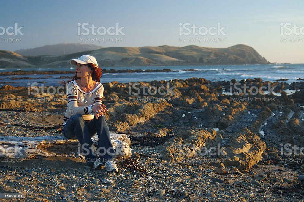 Woman on New Zealand beach at subset royalty-free stock photo