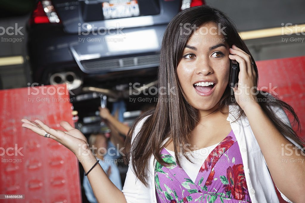 Woman on phone at auto shop royalty-free stock photo