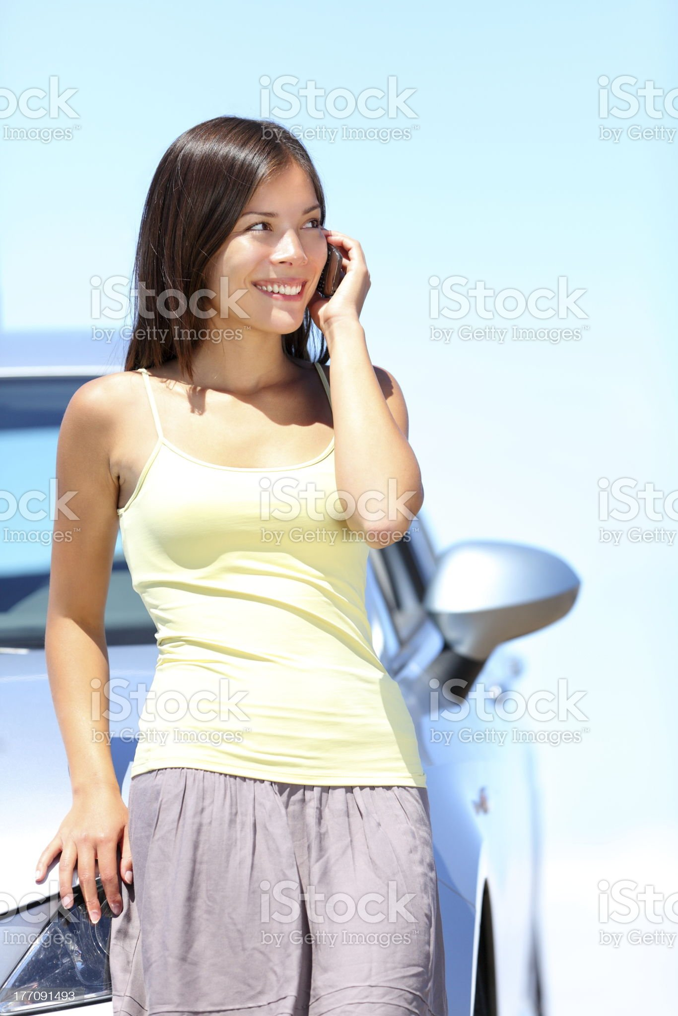 Woman on phone by car royalty-free stock photo