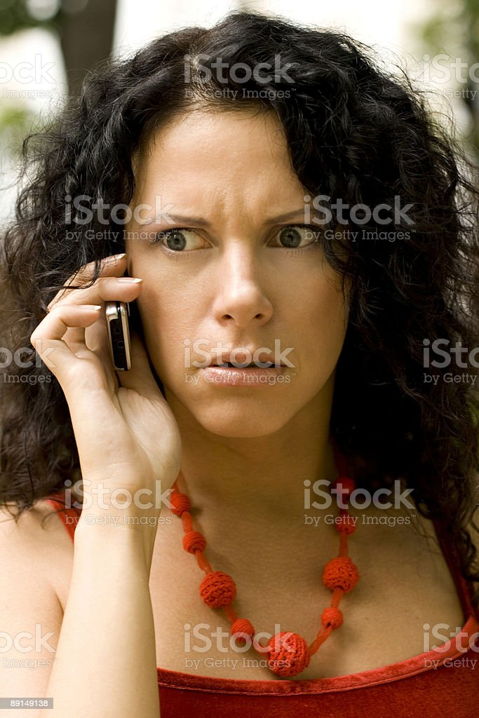 woman on phone getting bad news royalty-free stock photo