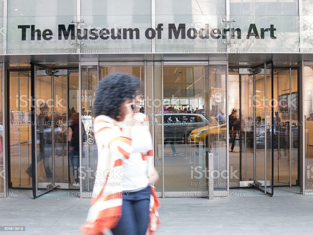 Woman on phone in front of MoMA NYC stock photo