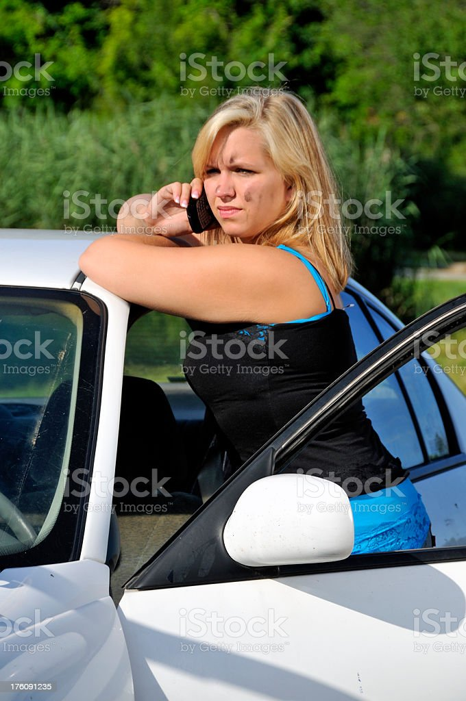 Woman on Phone with Auto Garage royalty-free stock photo