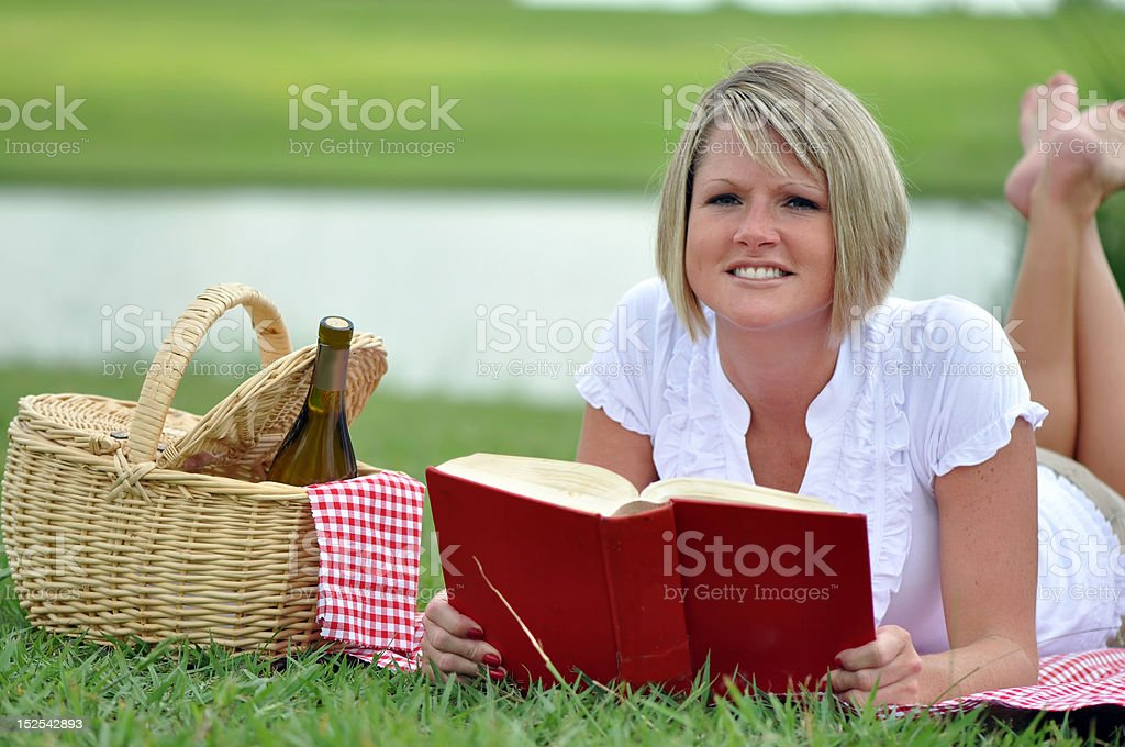 Woman on Picnic with Book and Wine stock photo