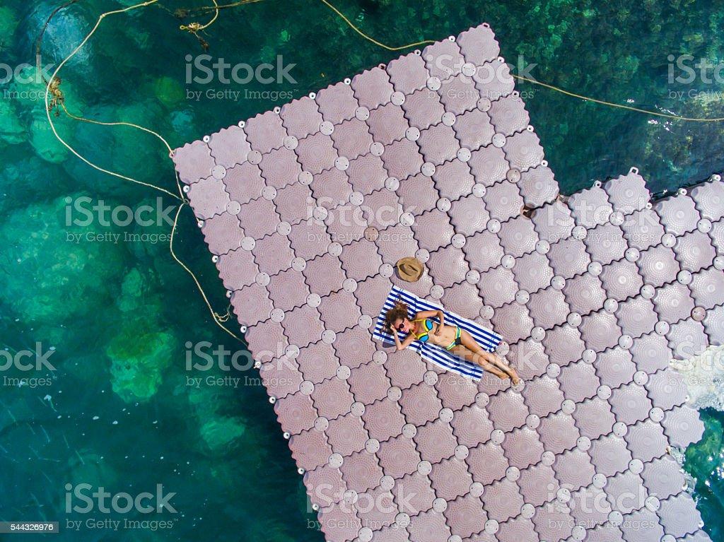 Woman on pontoon bridge aerial view stock photo