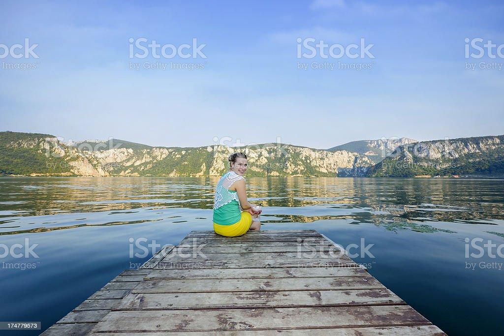 woman on pontoon bridge stock photo