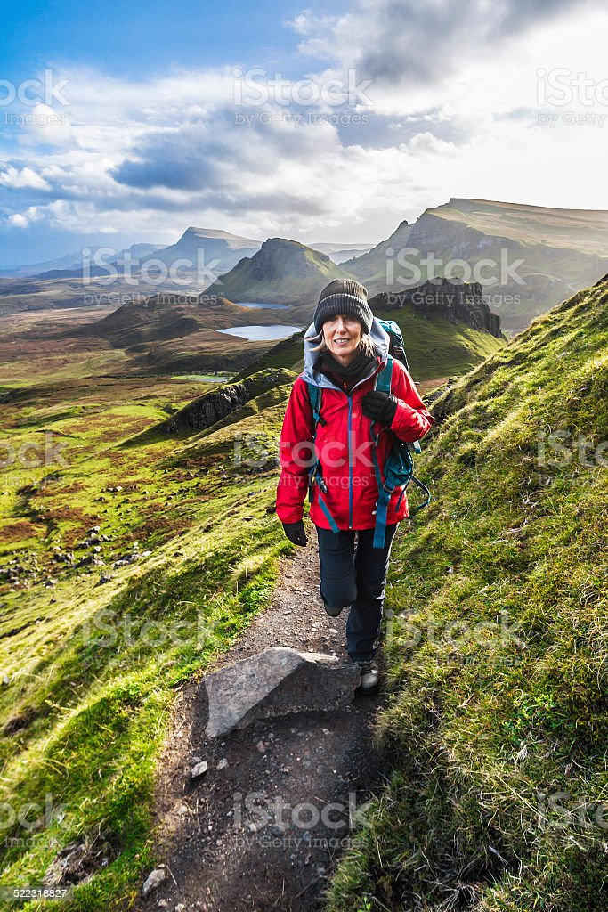 Woman on Quiraing Trail, Isle of Skye Scotland stock photo
