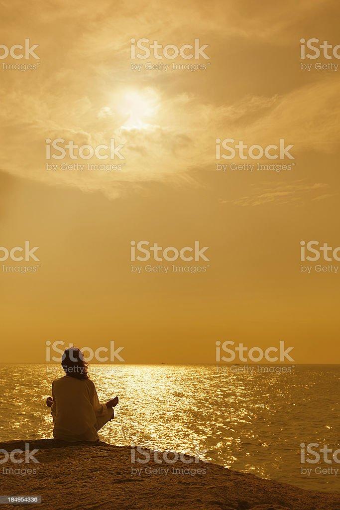 Woman on rock royalty-free stock photo