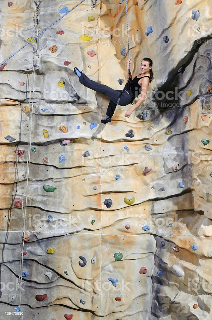 woman on rock wall in sport center royalty-free stock photo