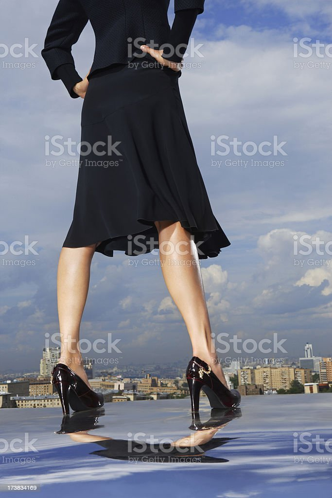 Woman on roof royalty-free stock photo