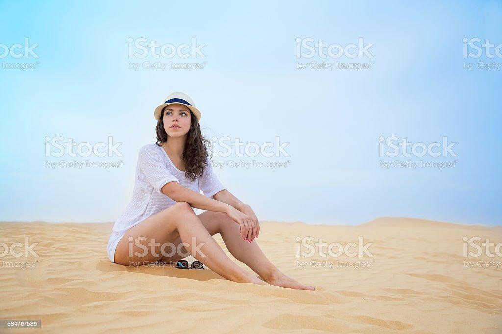 Woman on sand dune stock photo