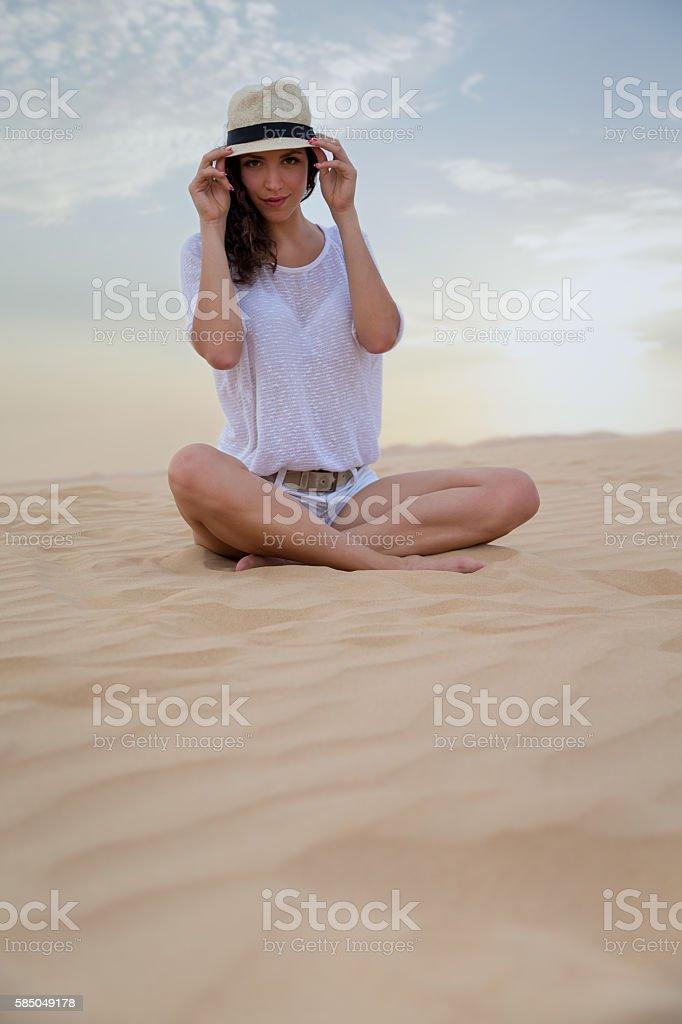 Woman on sand sune stock photo