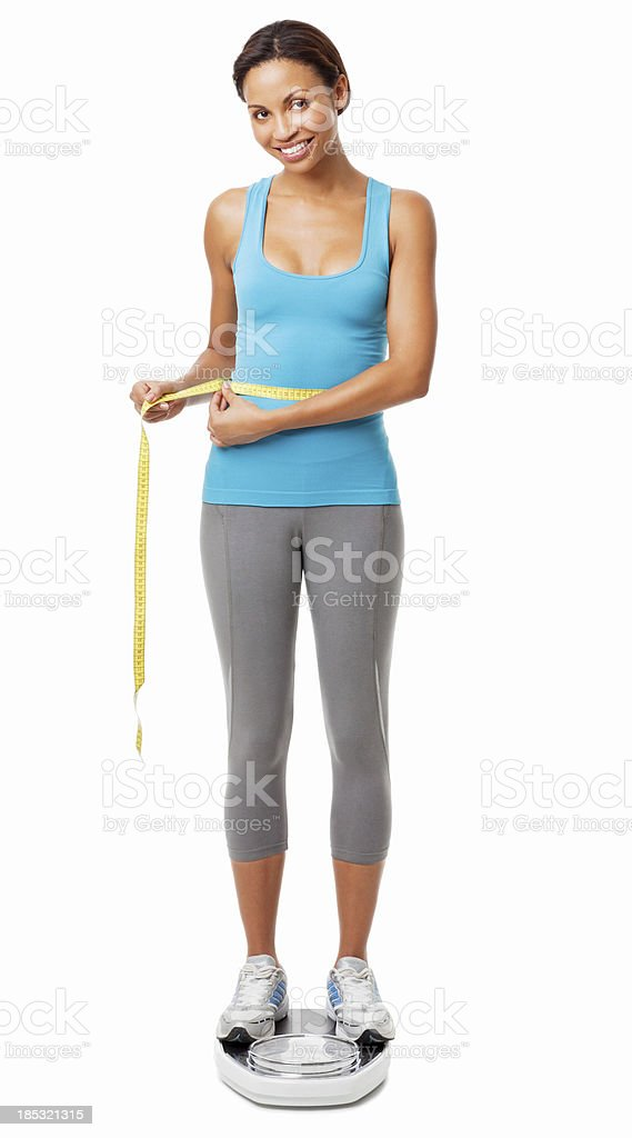 Woman on Scale Measuring Her Waistline - Isolated royalty-free stock photo