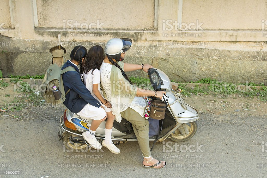 Woman on scooter royalty-free stock photo
