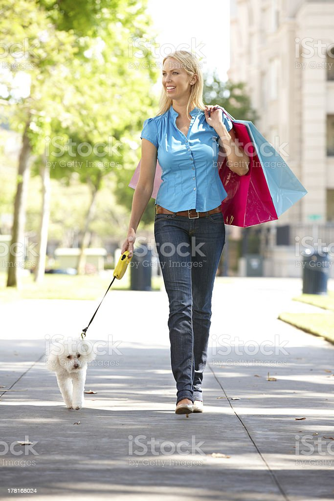 Woman on shopping trip with dog stock photo