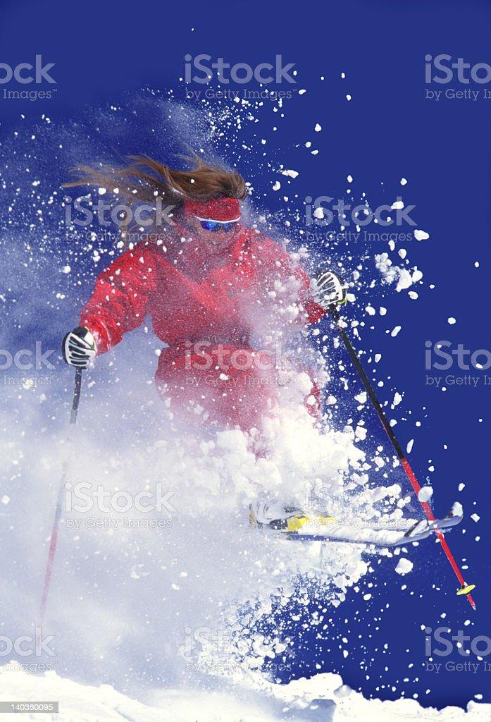 Woman on Snow Skis Flying Through Powder royalty-free stock photo