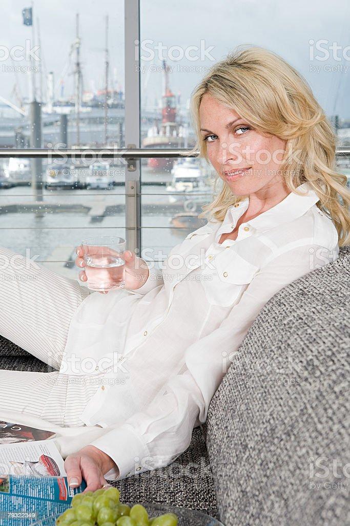 Woman on sofa royalty-free stock photo