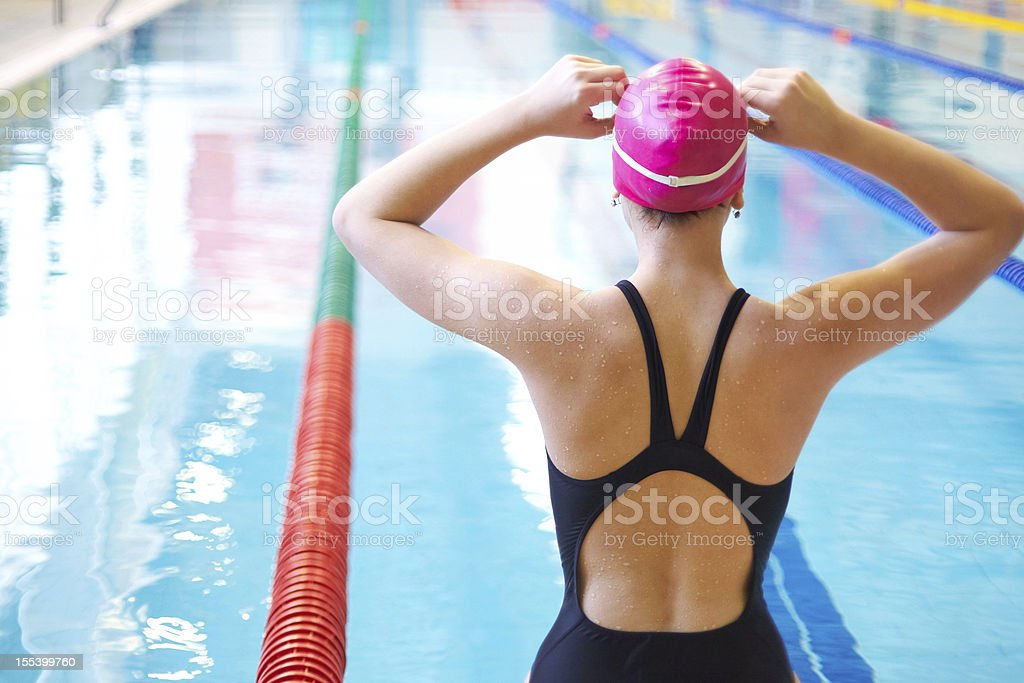 woman on start of swimming stock photo
