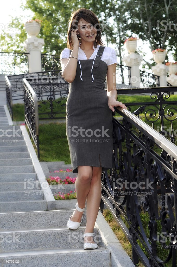 Woman on steps smiling royalty-free stock photo