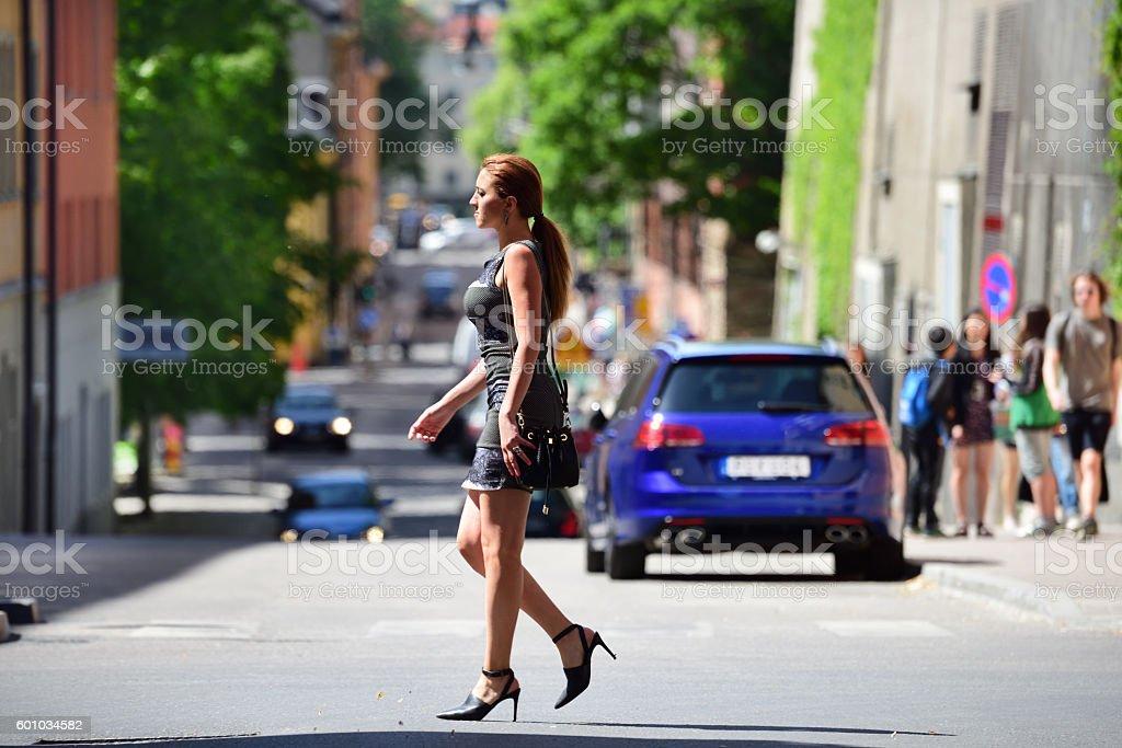 Woman on street, zebra crossing stock photo