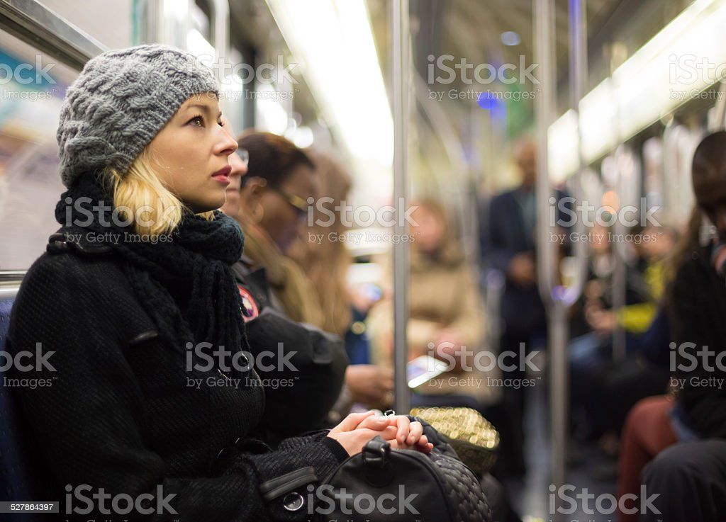 Woman on subway. stock photo