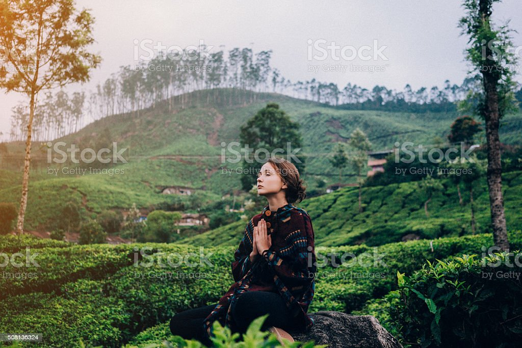 Woman on tea plantation in India stock photo