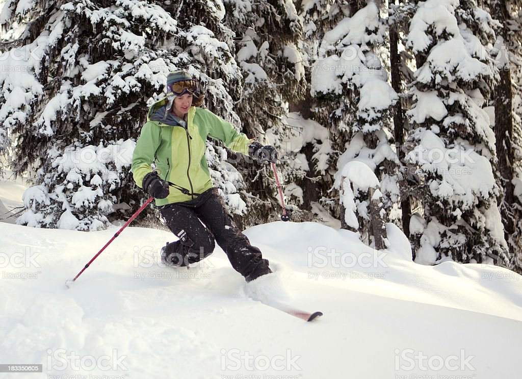 Woman on telemark skis in fresh powder royalty-free stock photo