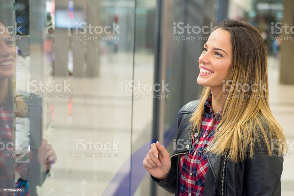 woman on the background of shop window in shopping center stock photo