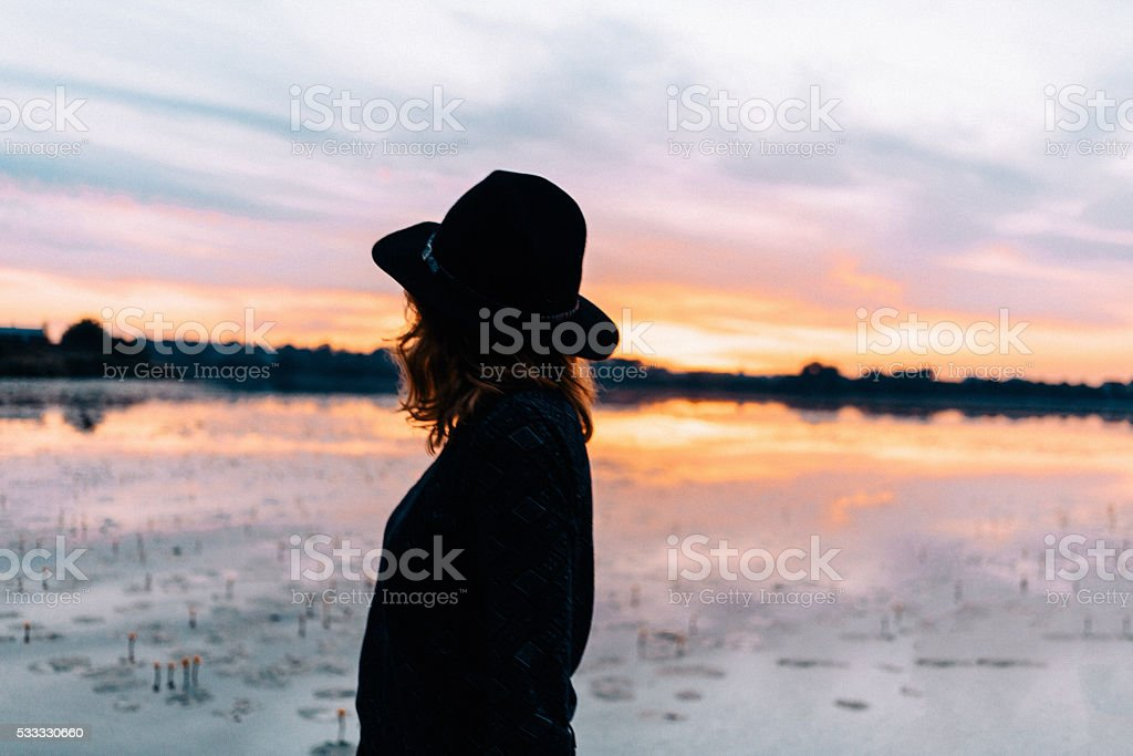 Woman on the background of the lake stock photo