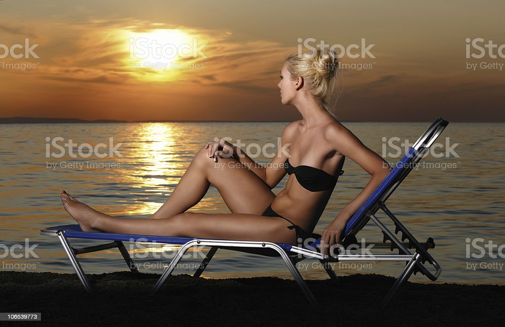Woman on the beach at sunset royalty-free stock photo