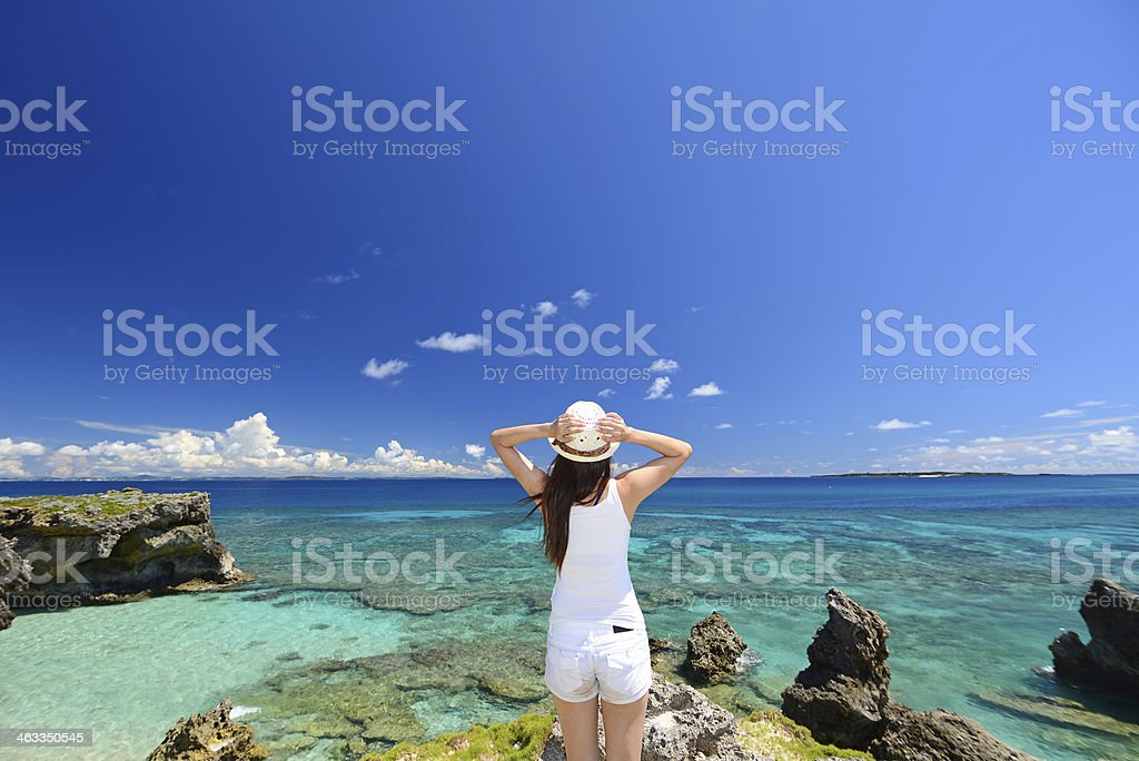 Woman on the beach enjoy sunlight stock photo