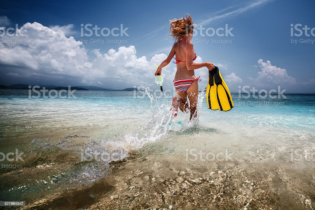 Woman on the beach stock photo