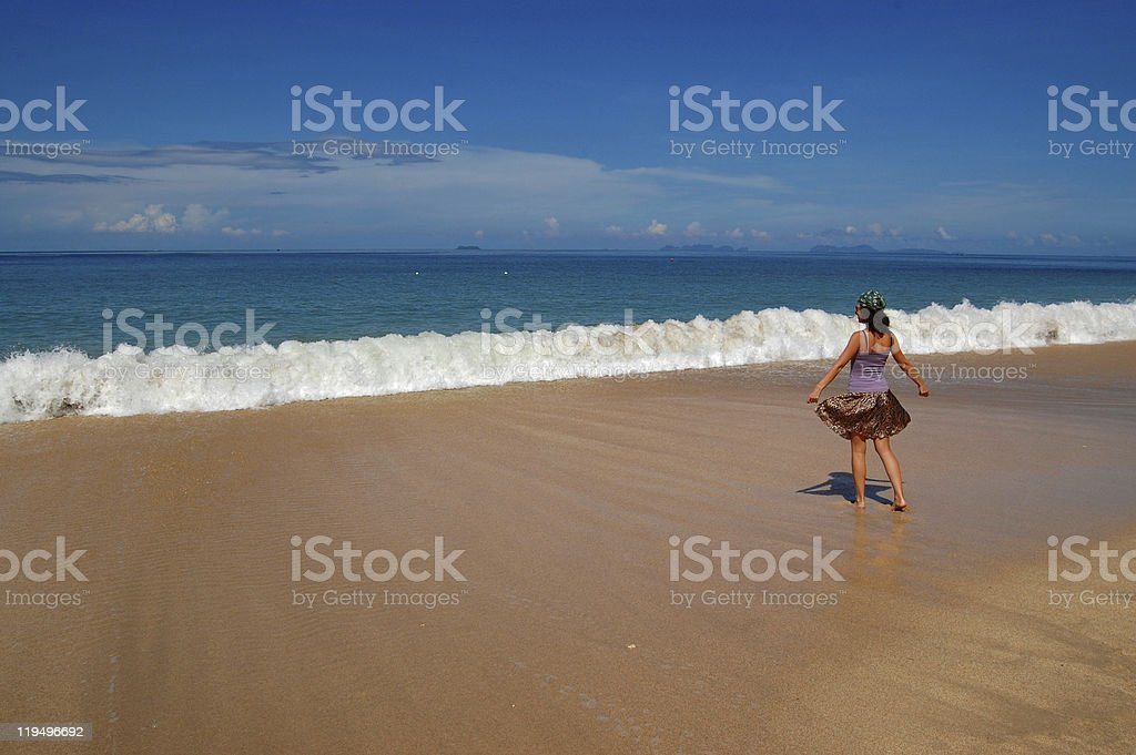 Woman on the beautiful tropical beach stock photo