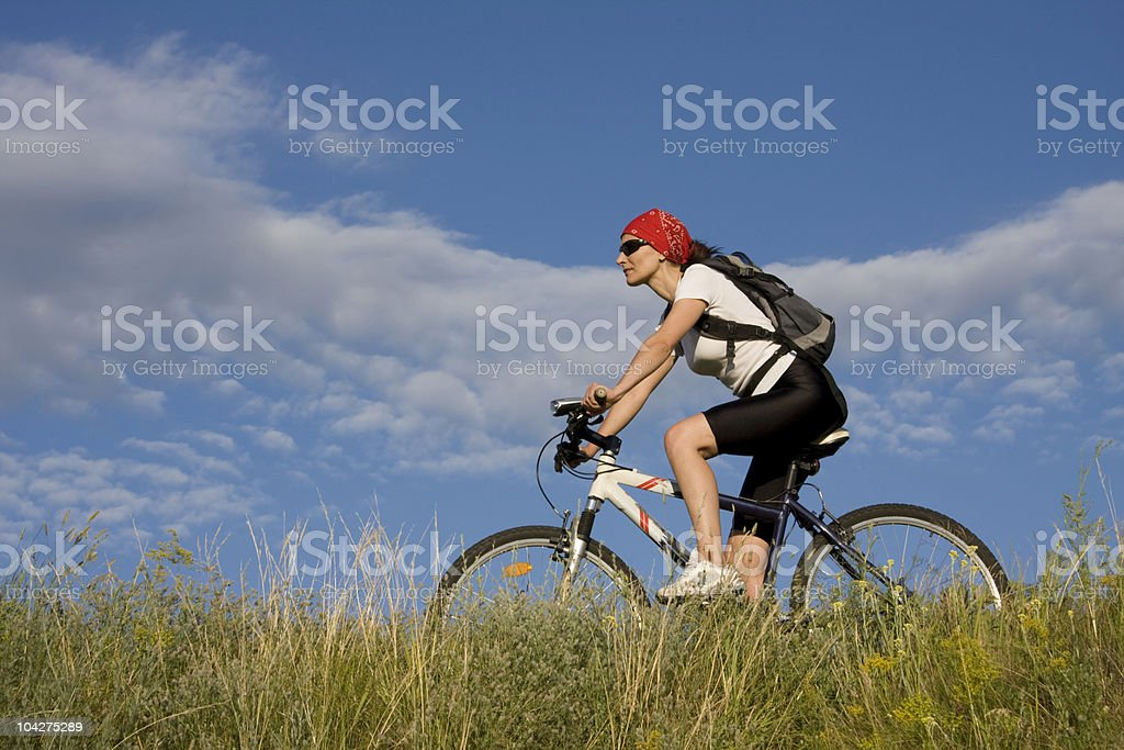 woman on the bicycle royalty-free stock photo