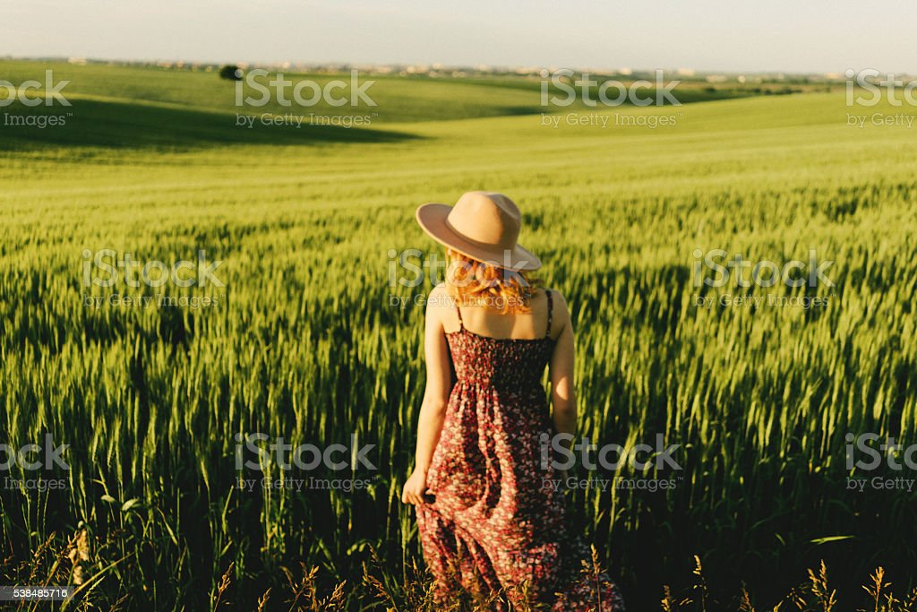 Woman on the field stock photo