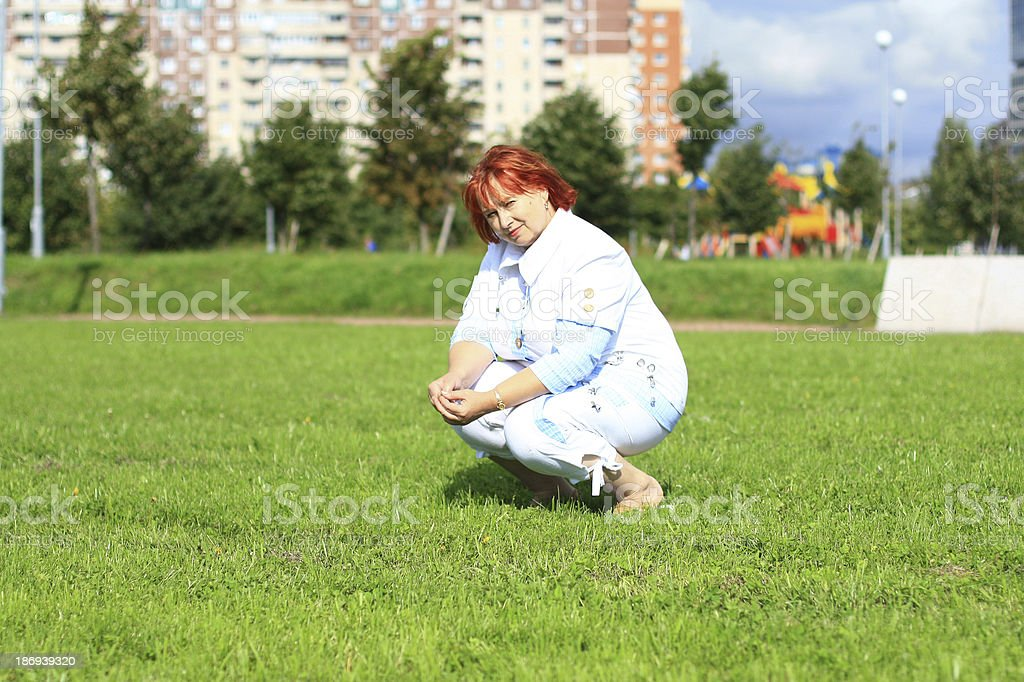 woman on the green grass royalty-free stock photo