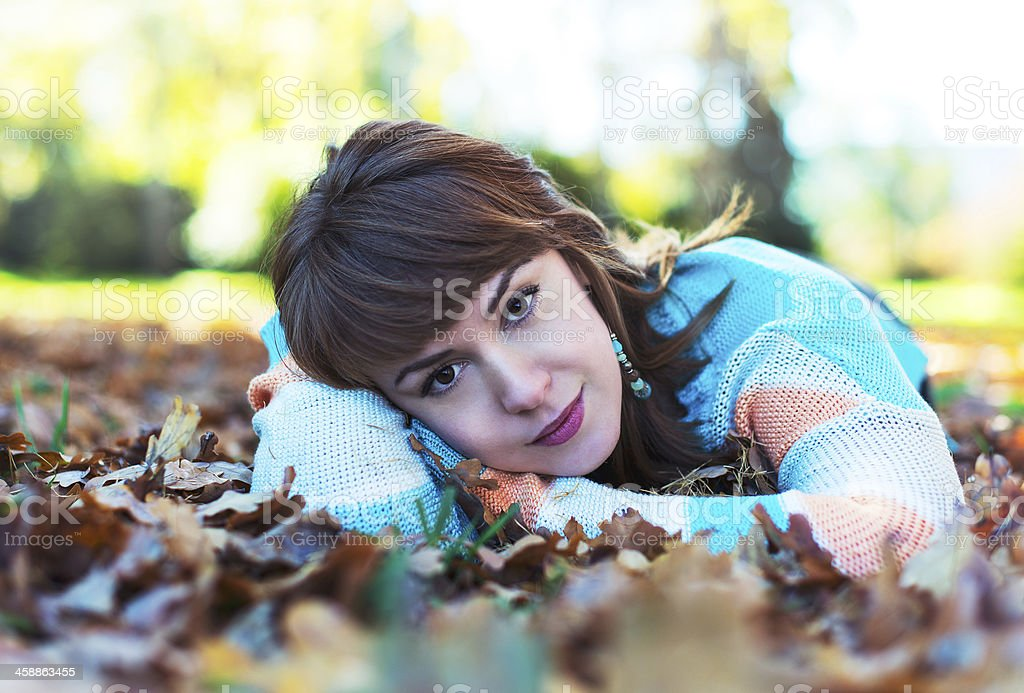 Woman on the leaves royalty-free stock photo