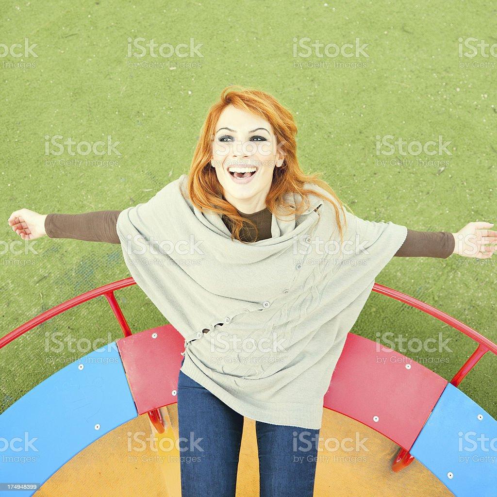 Woman on the Merry Go Round stock photo