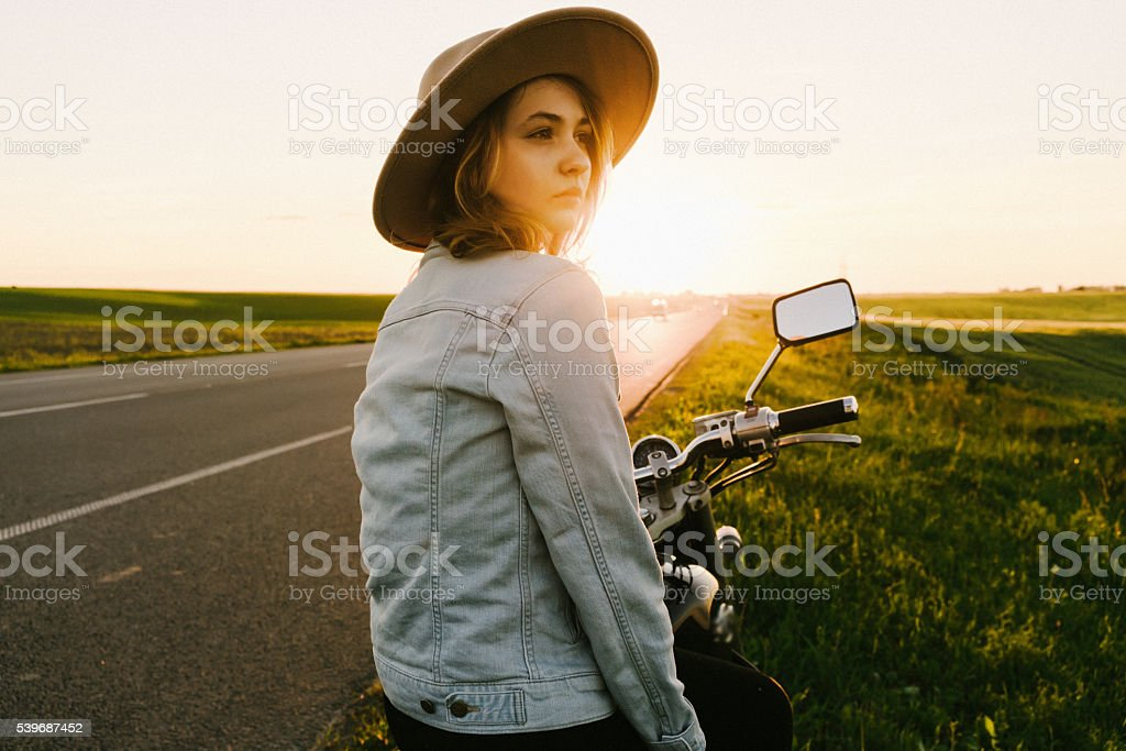 Woman on the motorcycle stock photo