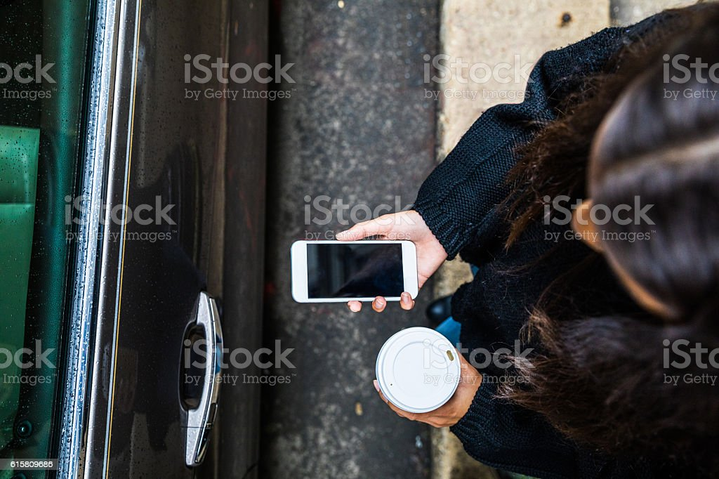 Woman on the move looking for car pooling stock photo