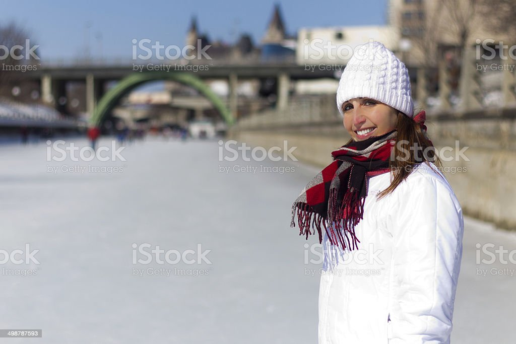 Woman on the Ottawa Rideau Canal Skateway during winter stock photo