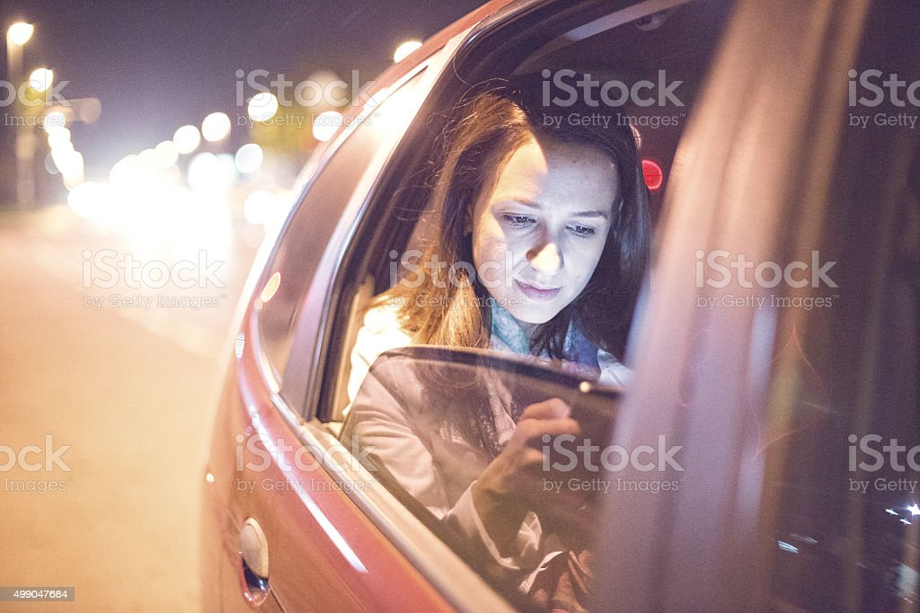 Woman on the phone in the cab stock photo
