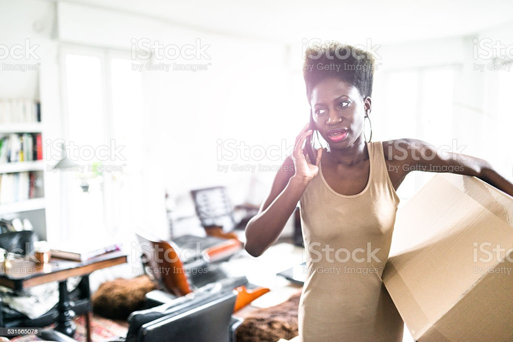 woman on the phone moving the house stock photo