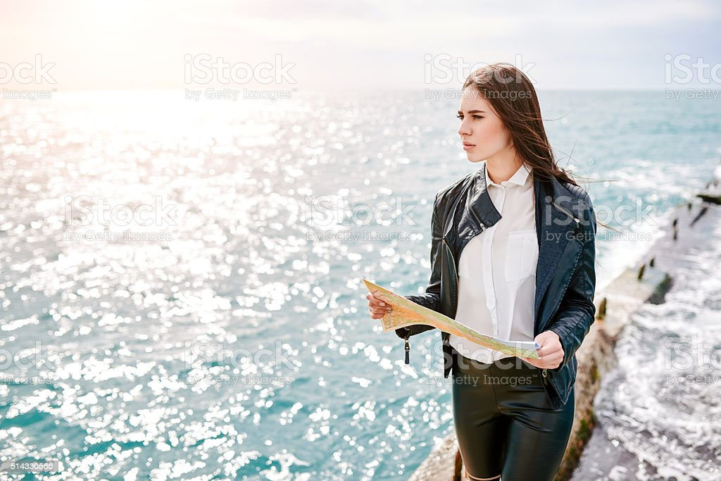 Woman on the pier watching map stock photo