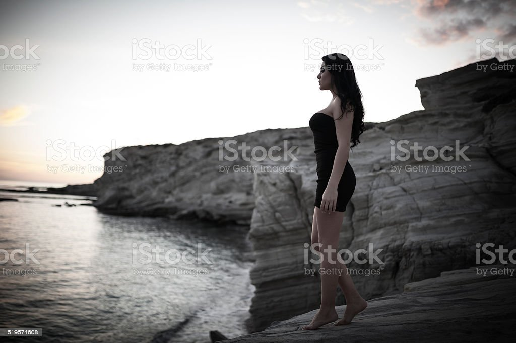 Woman On The Rocks stock photo