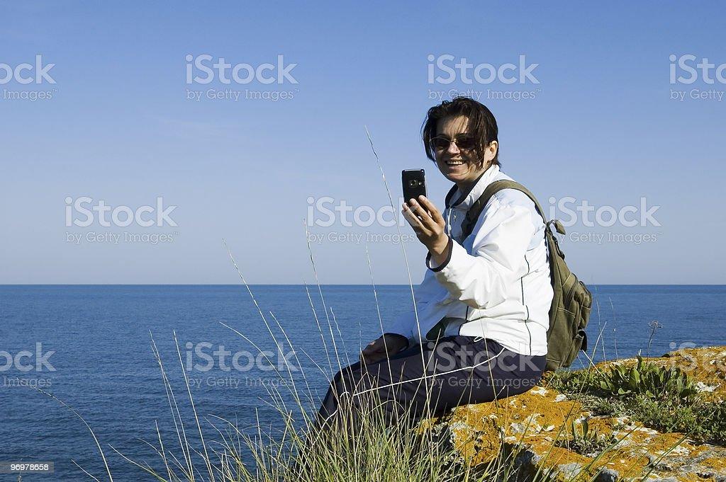 Woman on the rocks stock photo