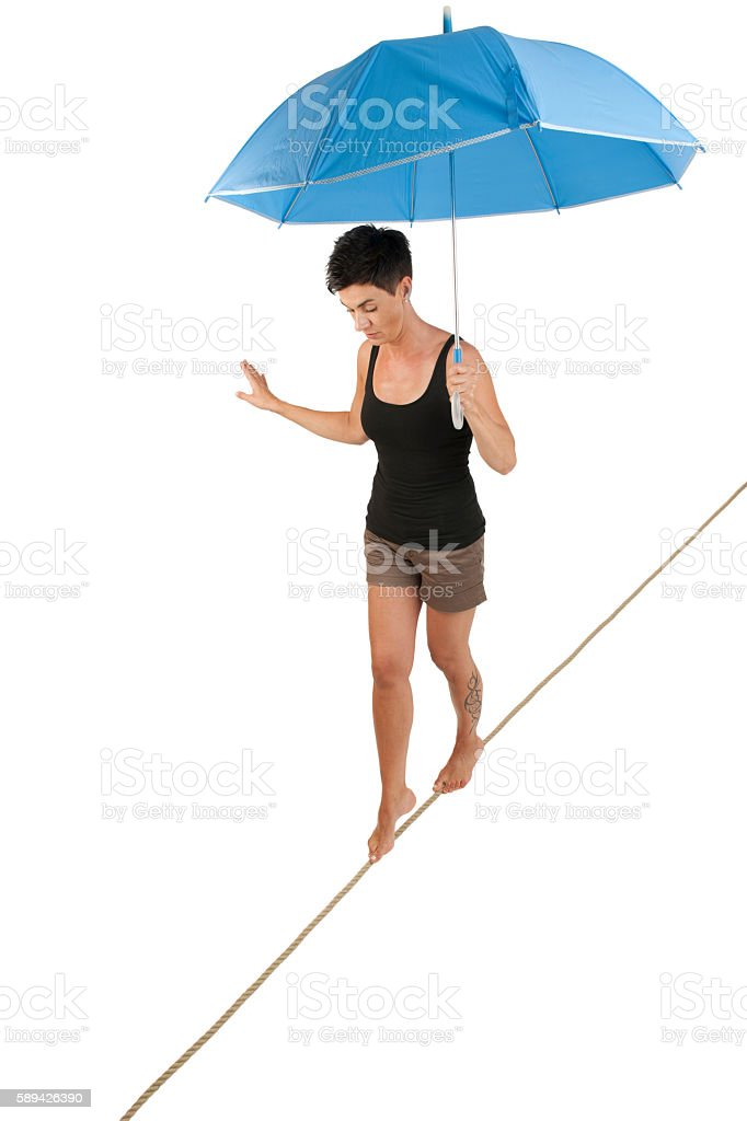 woman on the rope with umbrella stock photo